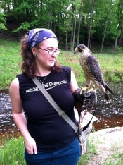 Mia from our Water Program enjoys a visit with Alvin the Falcon at an EPA field day event. (2012)