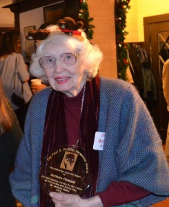 Barbara receiving the award at the holiday party.